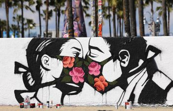 Wall mural of two heads kissing, wearing floral face masks