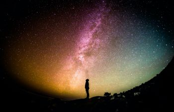 Person looking into the Milky Way