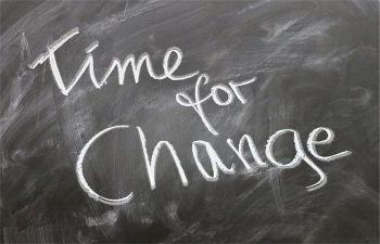 'Time for change' written in chalk on a blackboard