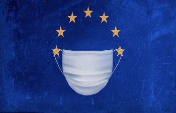 A surgical mask covering the EU flag