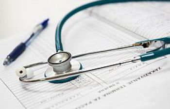 stethoscope laying on documents
