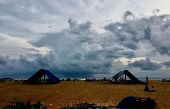 Rain clouds approach the shores of Puthiyathura village of Thiruvananthapuram district in southwestern India
