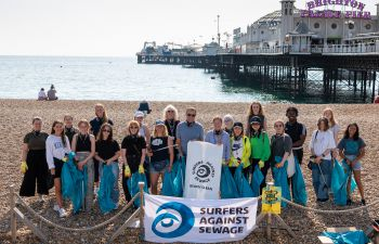 Group image on Brighton Beach of beach cleaners