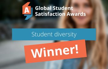 A banner detailing the University's global award win in student diversity is laid over a faded out image of a female student wearing a coat