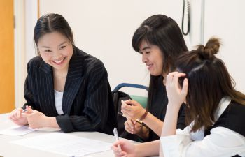 Three female students in an English Language for Academic Study session