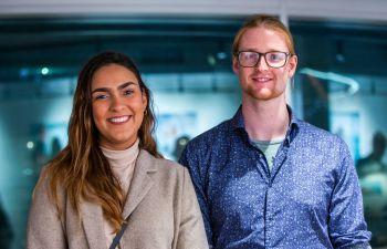 Portrait close up photo of recent graduates Isabela Rocha Faria and James Bowyer