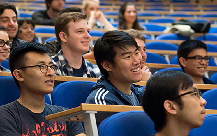 Students smiling and enjoying a lecture