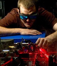 JRA student James Sayers at work on the laser table for his physics project