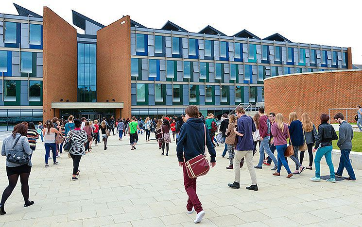 Students and staff head towards the building