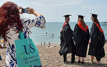 Students celebrating their graduation on Brighton seafront