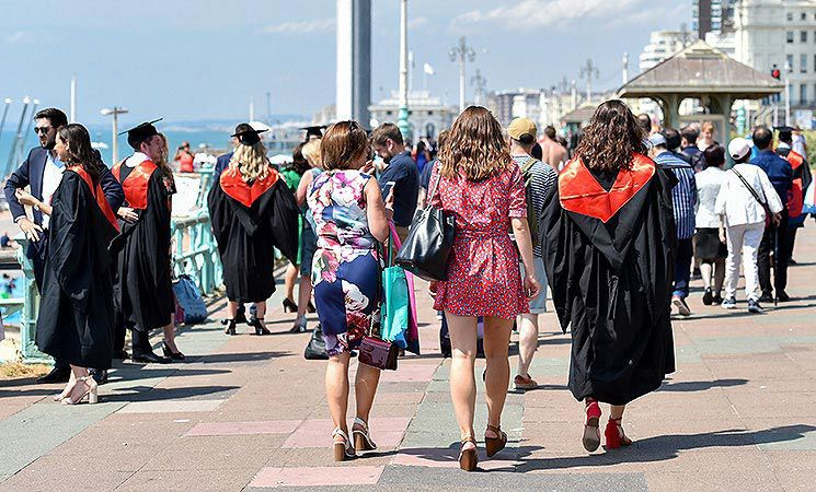 A group walk away from the Brighton Centre after a ceremony