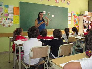 Teacher teaching pupils at a school