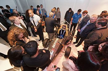 Attendees examine the car at the Formula Student launch event