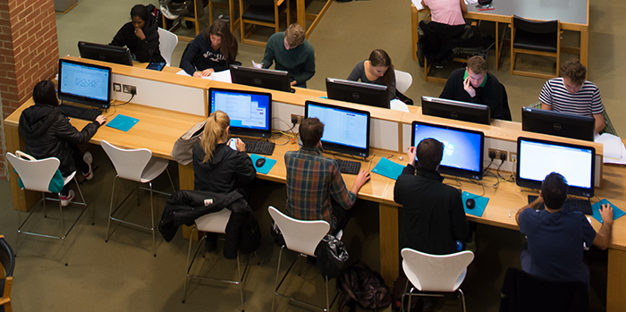 Students working at computers in the University library