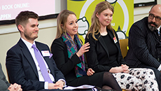 A panel of employers from international organisations talking to graduates at a recruitment event
