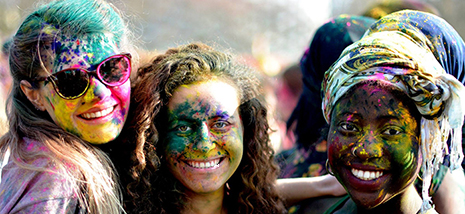Three Sussex international students celebrating Holi as part of our One World Week