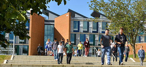 Students of the University of Sussex Business School, walking away from the Jubilee Building where they study