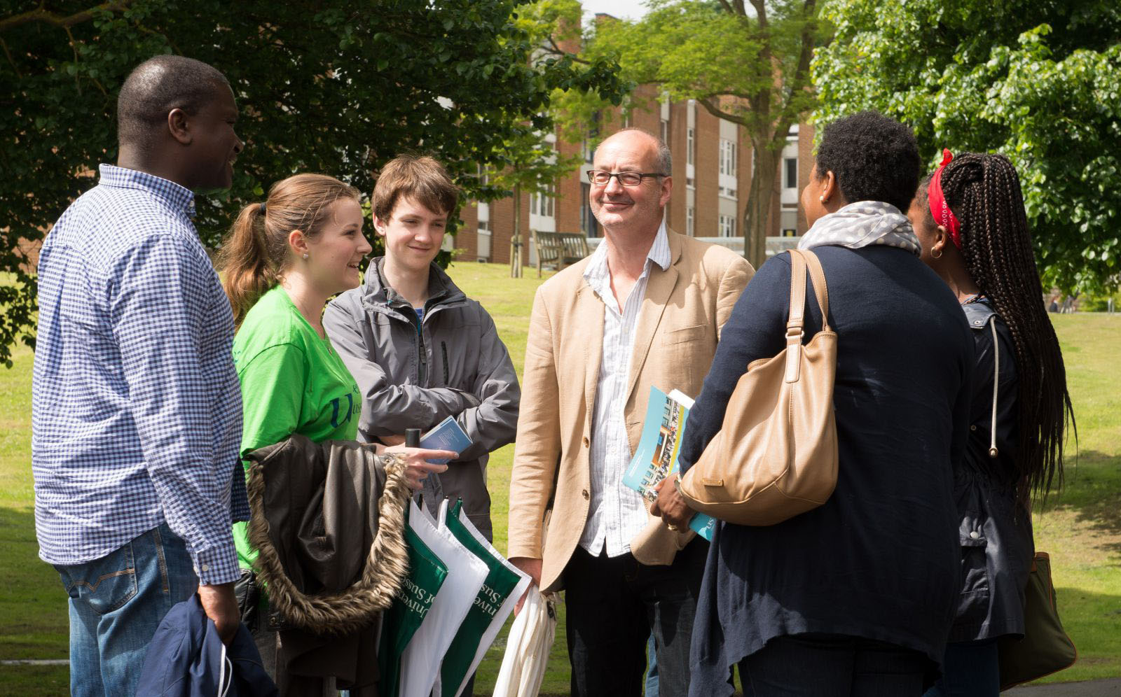 A group of people being shown around Sussex campus by one of our guides