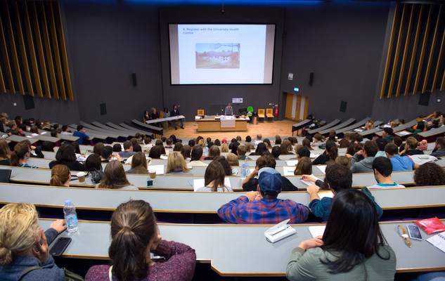 Students listening to a presentation in a lecture theatre