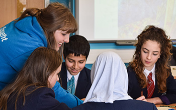 A Sussex worker talking to school pupils as part of a Widening Participation event