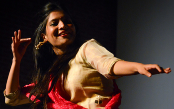 A woman dances during Diwali celebrations