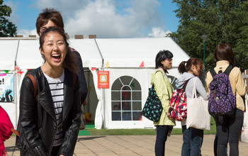 Potential students look around the University of Sussex campus