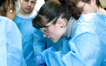 Medical students in an operation