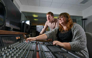 An academic using sound system equipment at the University of Sussex
