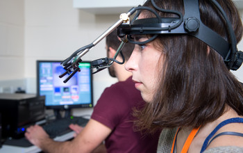 A researcher using psychology equipment at the University of Sussex