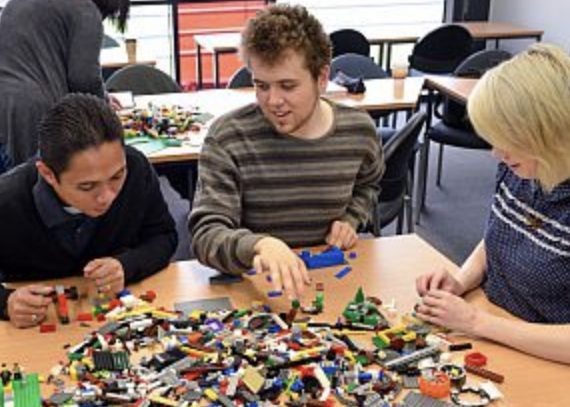 People building objects with lego