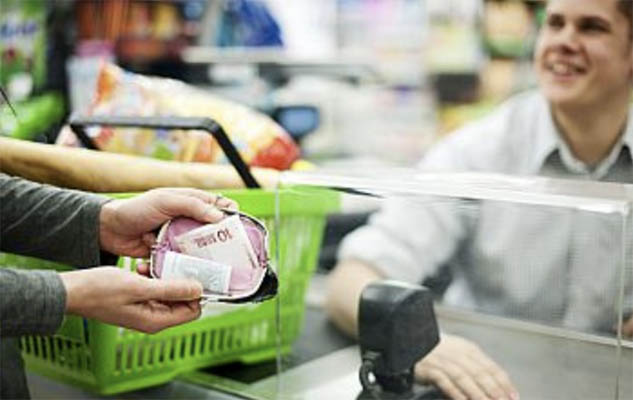 A supermarket with someone paying at a checkout
