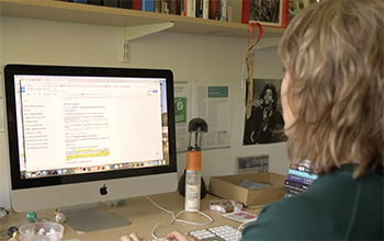 Academic on a computer at the University of Sussex