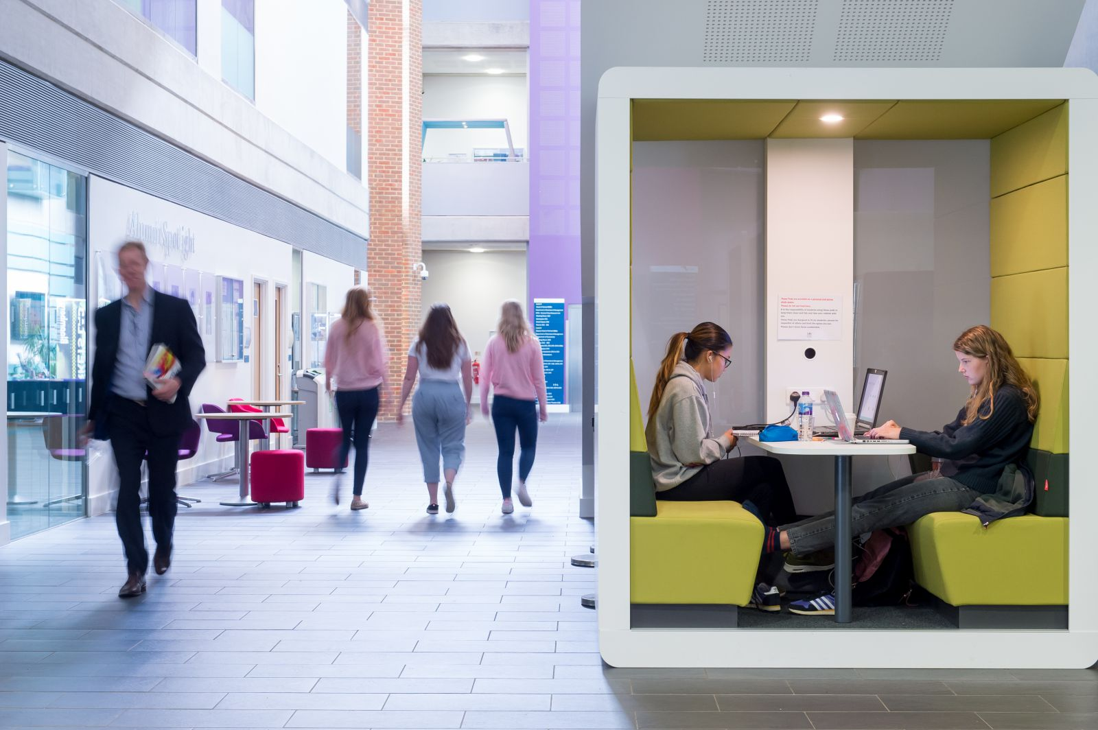 Students use a study pod in the Jubilee Building, home to the University of Sussex Business School