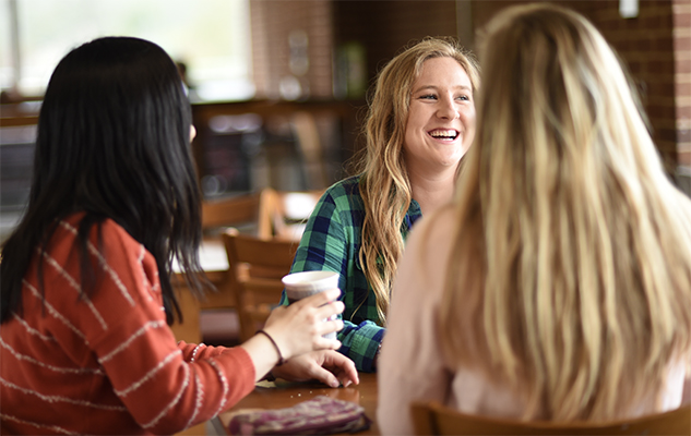 Students talking in a cafe at the University of Sussex