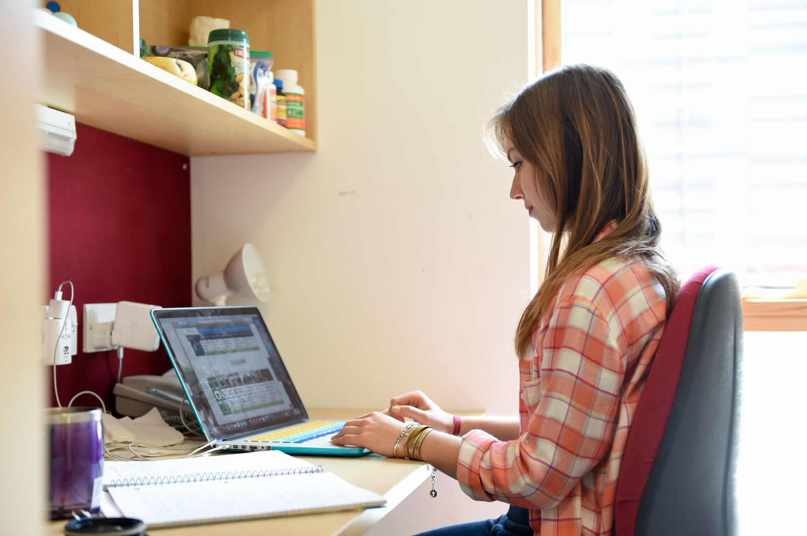 Student studying in her halls of residence at the University of Sussex