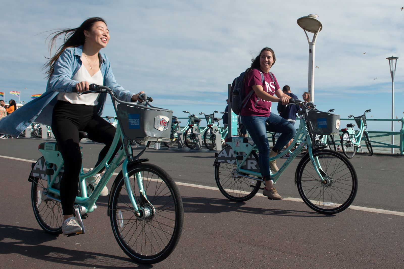 Students cycling along the seafront in Brighton