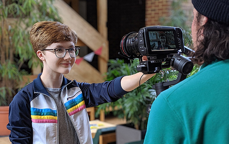 A videographer at a filming shoot at the University of Sussex