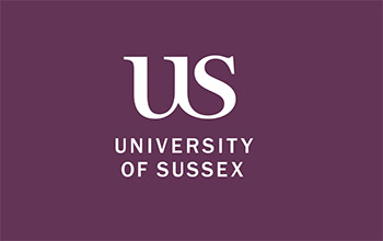 The University of Sussex logo behind the reception desk in Sussex House