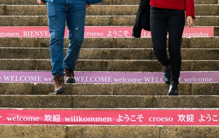 Icon: steps leading up outside campus, with 'hello' in various languages printed on the side of each
