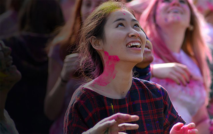 Students celebrate the Holi festival at the University of Sussex