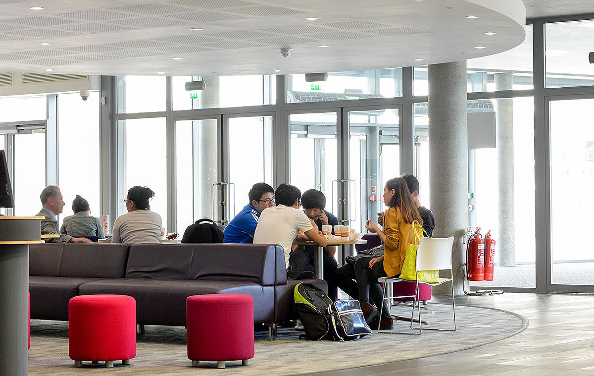 Students and staff relaxing in the social space